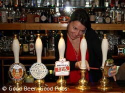 Annie attending to the pump clips at the Dispensary, Aldgate