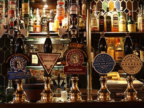 Picture of the Harp, Covent Garden - pump clips on the bar