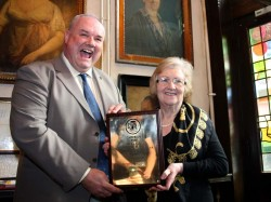 Julian Hough of CAMRA gives Bridget the National Pub of the Year Award