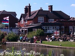Photo of the Rowbarge pub, Guildford from across the Wey Navigation
