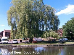 Photo of the Rowbarge pub, Guildford showing the riverside beer garden