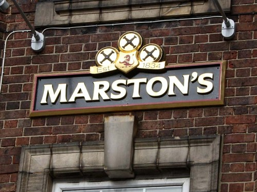 Marston's Logo high on the wall outside the Wellington, Waterloo